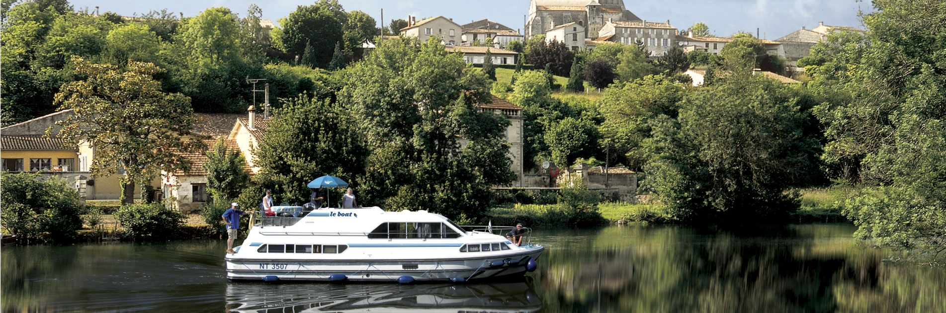 Slow sailing on riverboat in Charente